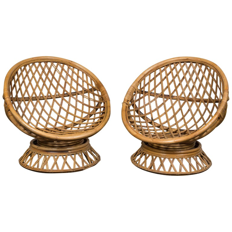 Pair of Circular Rattan Saucer Chairs For Sale