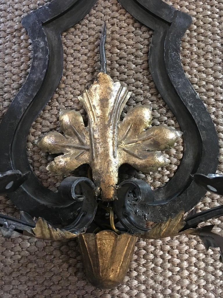 France Pair of Wrought Iron and Antique Gold Patinated Wall Lights  For Sale 4