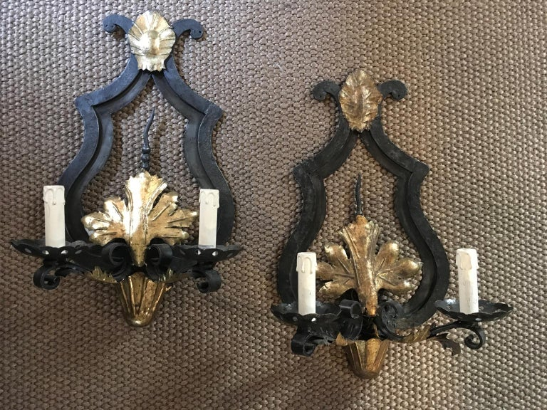 Carved France Pair of Wrought Iron and Antique Gold Patinated Wall Lights  For Sale
