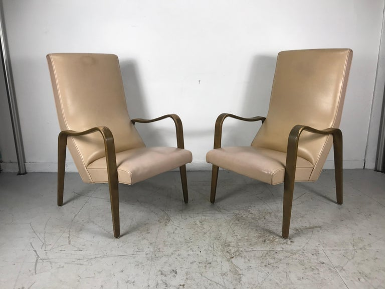 Pair of Classic Mid-Century Modern bentwood lounge chairs by Thonet, stunning lines, extremely comfortable, rare high back version, retain original finish, well worn finish, leaving it up to the buyers discretion, refinish, lacquer etc? Would be