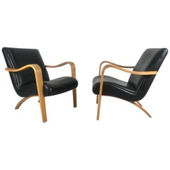 Pair of Classic Modernist Bent Plywood Arm Lounge Chairs by Thonet