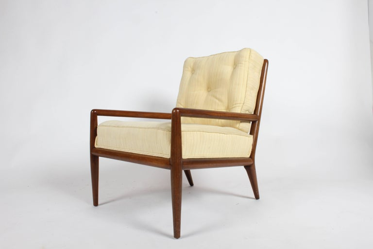 Pair of elegant T.H. Robsjohn-Gibbings for Widdicomb lounge chairs. Walnut frames with original upholstery, note that attached seat cushion is thicker and proper tufting and buttons on side of back cushion as Gibbings originally designed for the