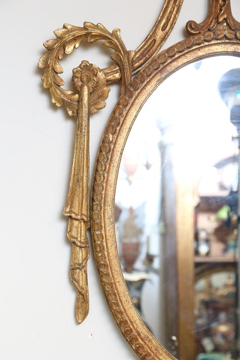 Pair of Classical-form Italian Carved Giltwood Oval Mirrors In Good Condition For Sale In West Palm Beach, FL