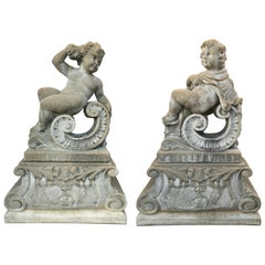 Pair of Classical Stone Composite Putti Garden Statues Holding Roses and Cloth