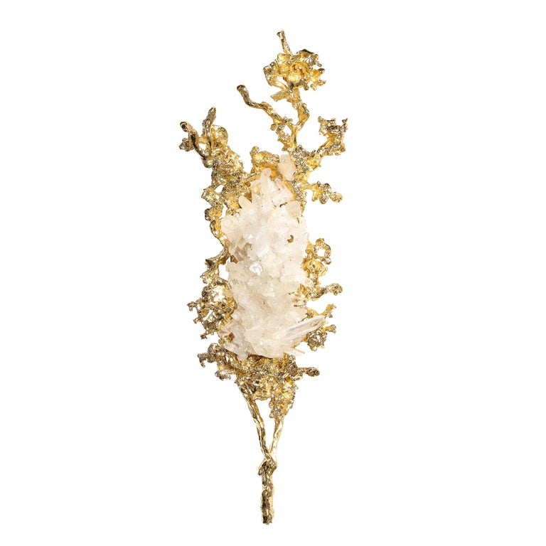 This stunning and sophisticated pair of modernist sconces were realized by the celebrated French artist Claude Boeltz. They feature graphic organic forms- recalling both oceanic and terrestrial forms from coral to tree branches- realized in exploded