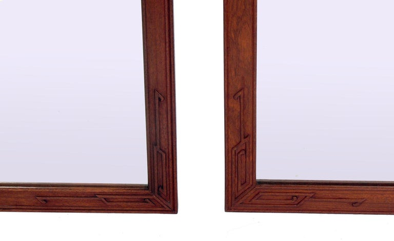 Chinese Pair of Clean Lined Mirrors with Subtle Asian Design For Sale
