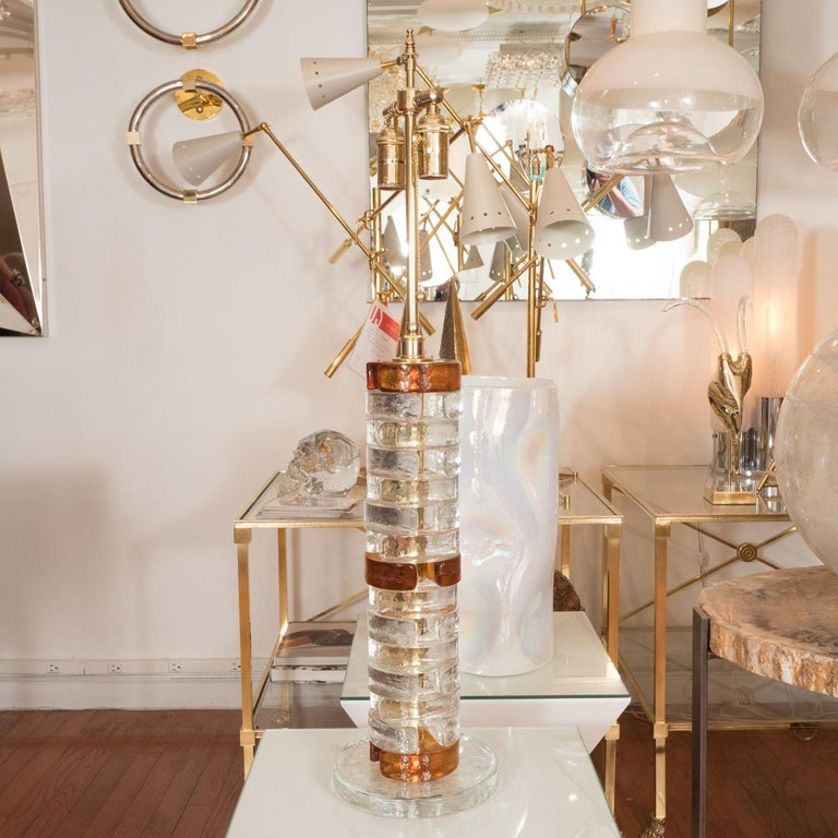 Pair of clear and amber glass table lamps composed of stacked elements.