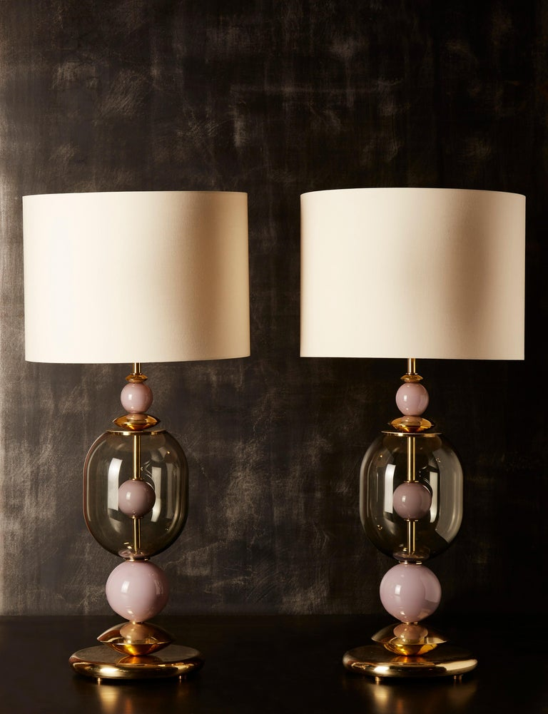 Pair of exquisite table lamps made of brass foot and central stem, brass inserts and dust pink Murano glass balls.