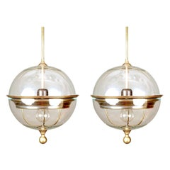 Pair of Clear Glass Globe Shaped, Brass Trim Pendant Lights, Italy, Contemporary