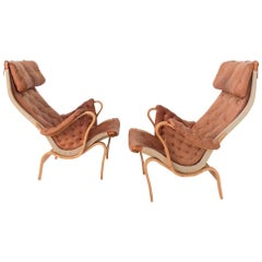 Pair of Cognac Leather Pernilla Armchairs by Bruno Mathsson, Sweden, circa 1970