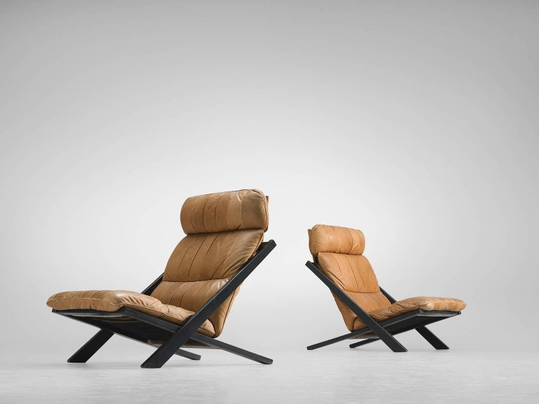 Pair of lounge chairs, in wood and leather by Ueli bergere for De Sede, Switzerland, 1970s.