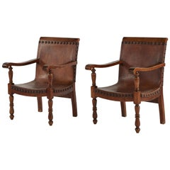 Pair of Colonial Armchairs in Leather