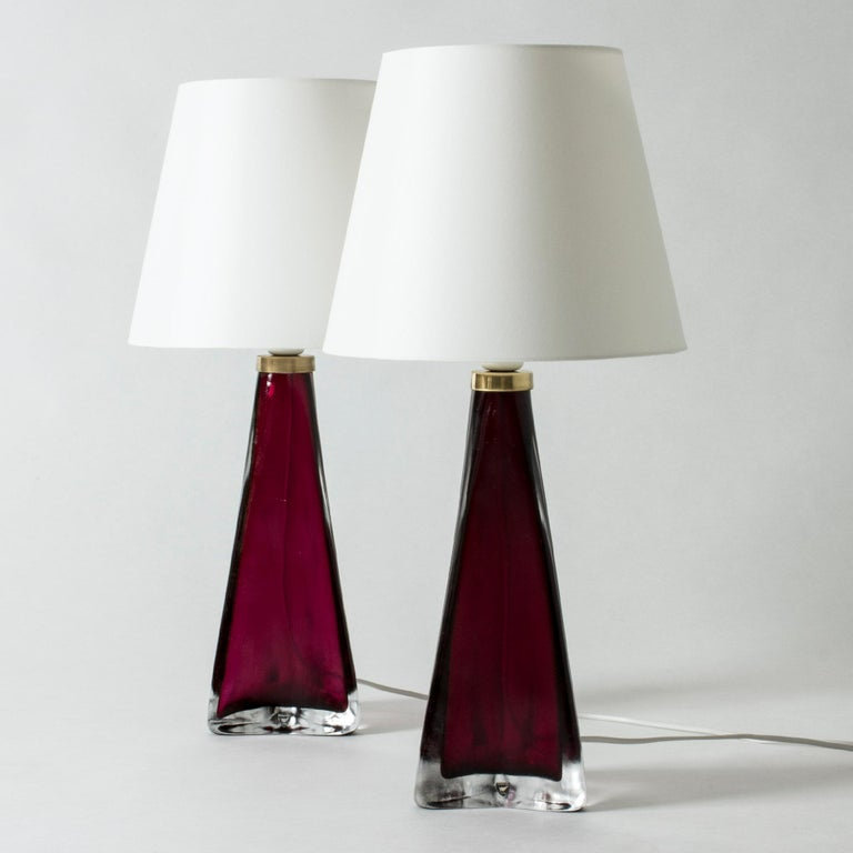 Pair of cool and luxurious table lamps by Carl Fagerlund, made in beautiful dark pink and clear glass. Tapering shape with a triangular base. Slightly frosted surface with structure. Rare color.