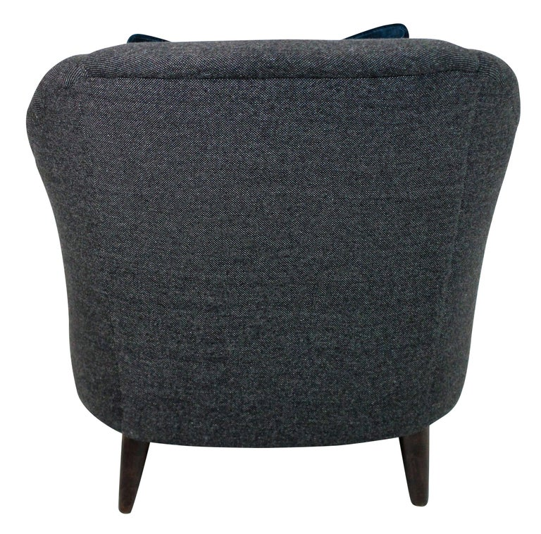 A pair of generous scale sculptural armchairs by Ulrich. Newly upholstered in dark grey wool.