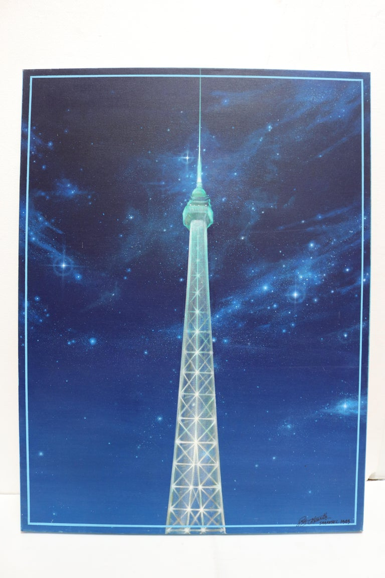 Pair of complementary acrylic paintings featuring the Eiffel Tower in Paris at night in glimmering blue and white hues.