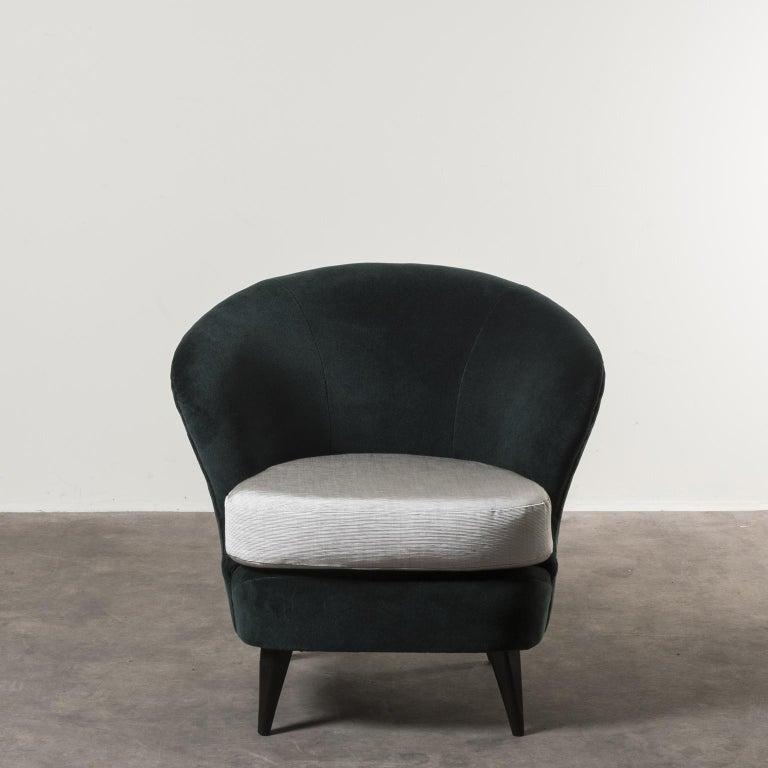 Pair of concha armchairs by Joaquim Tenreiro, Brazil, 1950. Manufactured by Tenreiro Mo´veis e Decorac¸o~es. Wood, fabric upholstery. Measures: 80 x 86 x H 72 cm H seduta: 41 cm. 31.4 x 33.8 x H 28.3 in H seat 16.2 in Literature: Soraia Cals,