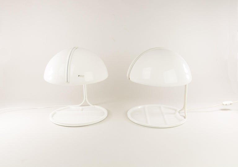 Luigi Massoni and Luciano Buttura designed theseConchiglia desk lamps for Harvey Guzzini in 1968. Harvey Guzzini produced the lamp from 1968 until 1980.  This surprisingexample of design has a metal structure that holds the Plexiglas shade and