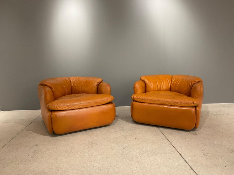 A pair of armchairs in leather designed by the Alberto Rosselli. These chairs are so inviting, so comfortable and in great shape. The unique design of the cushions which nestle in the frame make it a work of art. The leather is in good shape with a