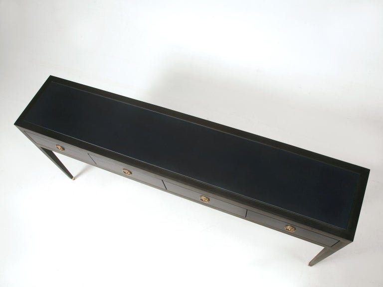 From the Old Plank Furniture Collection, are a matched pair (also available separately) of ebonized mahogany and leather wrapped console tables. Our Sofa table or Console table are handcrafted in the Old Plank workshop here in Chicago and are