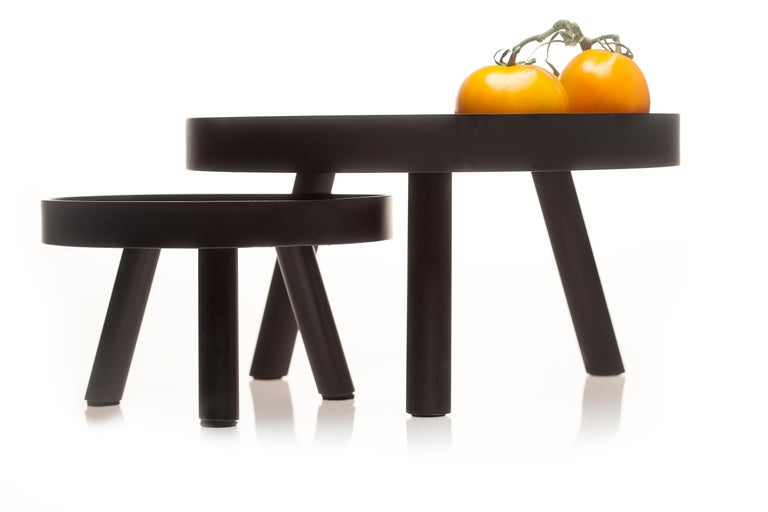 Lift and lift, too - set of two Simple. Elegant. Minimalist. The contemporary black serving trays titled Lift collection will redefine the landscape of your table setting. Inspired by the Pantheon in Rome with its powerful oculus and strong