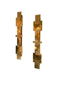 Pair of Contemporary brass geometrical sconces. Italie