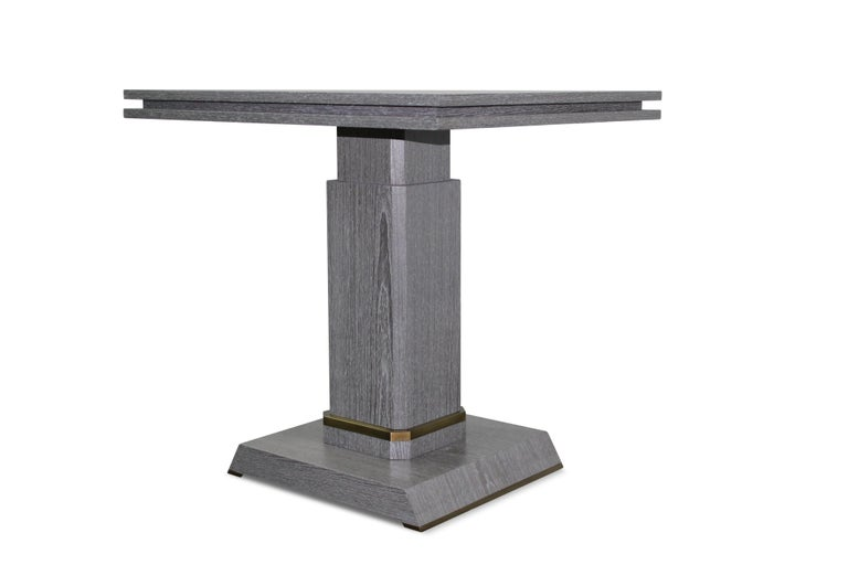 The Severino Tables are a pair of occasional cerused oak tables with bronze detailing at base and feet.