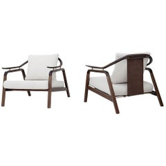 Pair of Contemporary Lounge Chairs in Leather and Brass Detailing