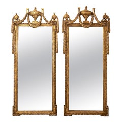 Pair of Continental Gilded Roman Swag and Urn Motif Mirrors