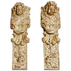 Pair of Continental Giltwood Architectural Fragments Headed by Putti