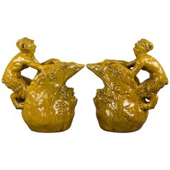Pair of Continental Yellow Glazed Figural Jugs, circa 1870