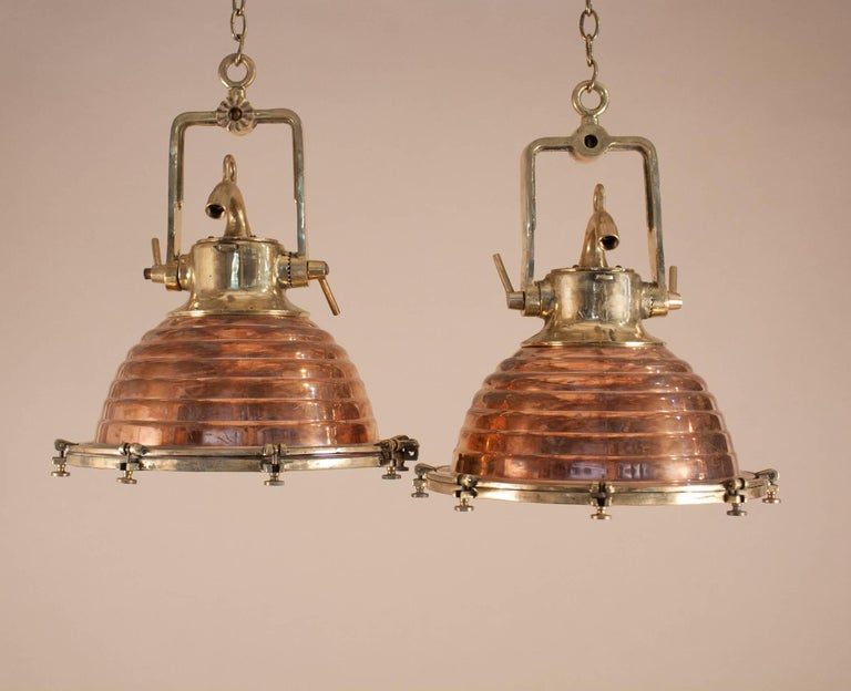 Pair of copper and brass nautical pendant lights at 1stdibs an authentic pair of midcentury medium sized copper and brass ships deck lights with aloadofball Images