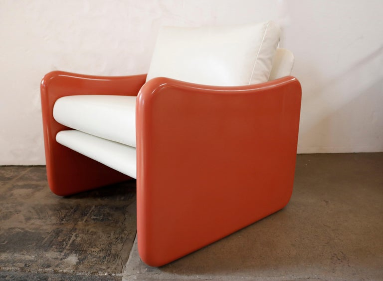 Unusual pair of cubic club chairs with coral pink lacquered sides in soft and textured white Naugahyde.