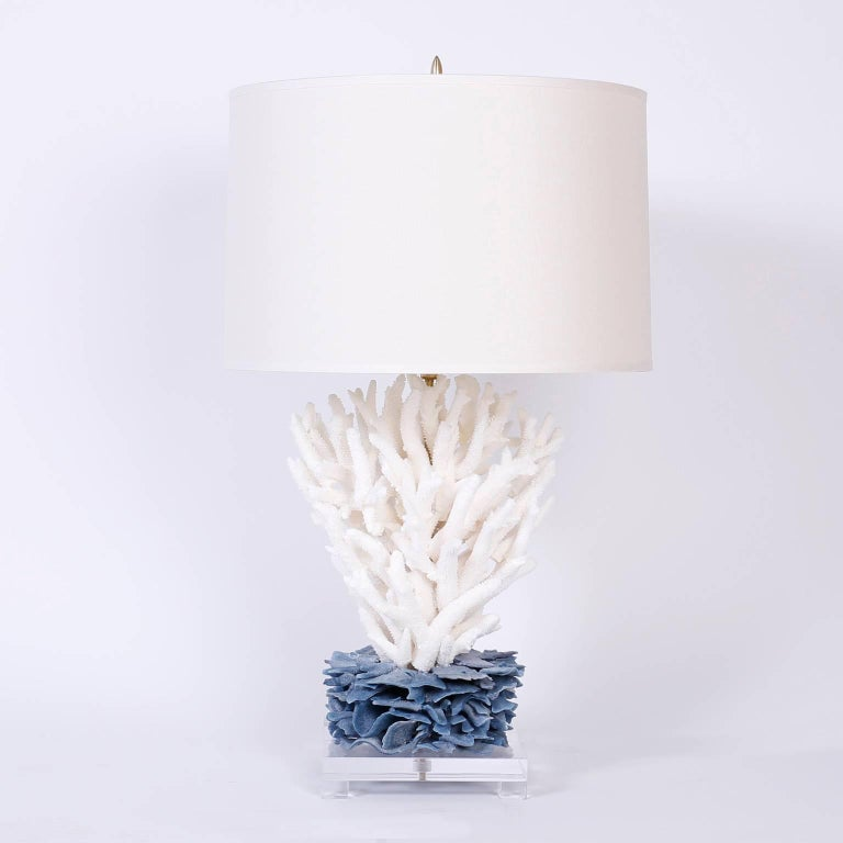 Alluring pair of sculptural table lamps custom designed and crafted by F. S. Henemader using staghorn coral and blue coral presented on footed Lucite bases.  Coral cannot be exported out of the USA without Cities permits. These permits are