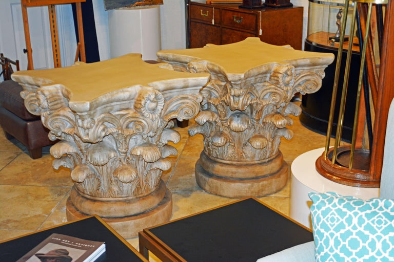These magnificent life-size Corinthian capitals are beautifully detailed in plaster and patinated for an attractive look. The capitals likely date to the 1930s and will make impressive table bases as well as decorative sculptures. Do to the photo