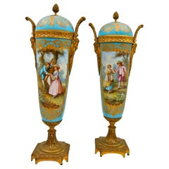 Pair of Covered Vases in Sèvres Porcelain and Gilt Bronze