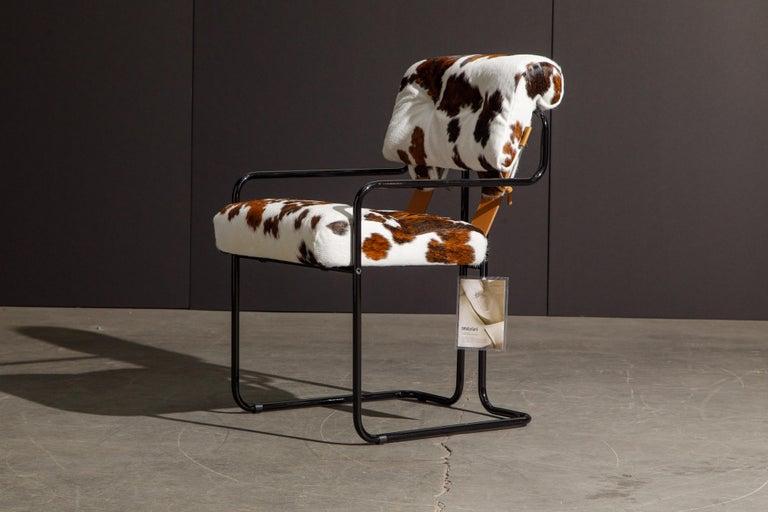 Currently, the most coveted dining chairs by interior designers are 'Tucroma' chairs by Guido Faleschini for i4 Mariani, and we have this incredible pair (2) of Tucroma armchairs in beautiful spotted brown and white cowhide leather with black