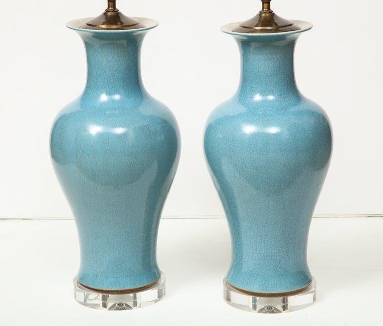 Ceramic Pair of Crackle Glazed Blue Vase Lamps For Sale