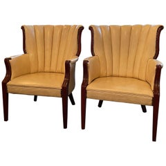 Pair of Cream Vinyl Mahogany Wingback Armchairs