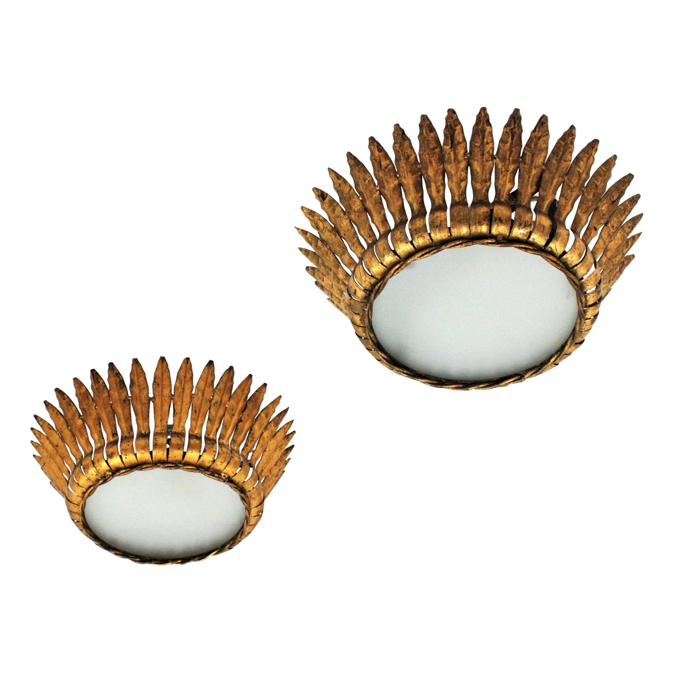 Pair of Crown Sunburst Light Fixtures / Pendants, Gilt Metal and Frosted Glass