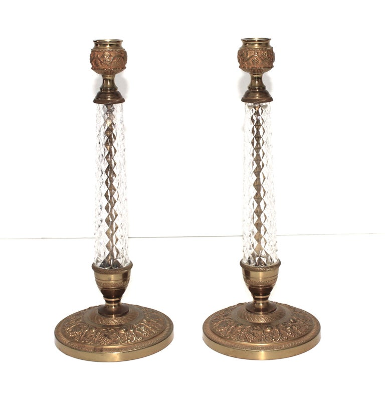 This stylish pair of Louis XVI style bronze and crystal candlesticks date to the 1960s and were created by Cristalleries de Sevres.   Note: Retains its original lable on the verso Cristal Taille M Lubliner Paris.