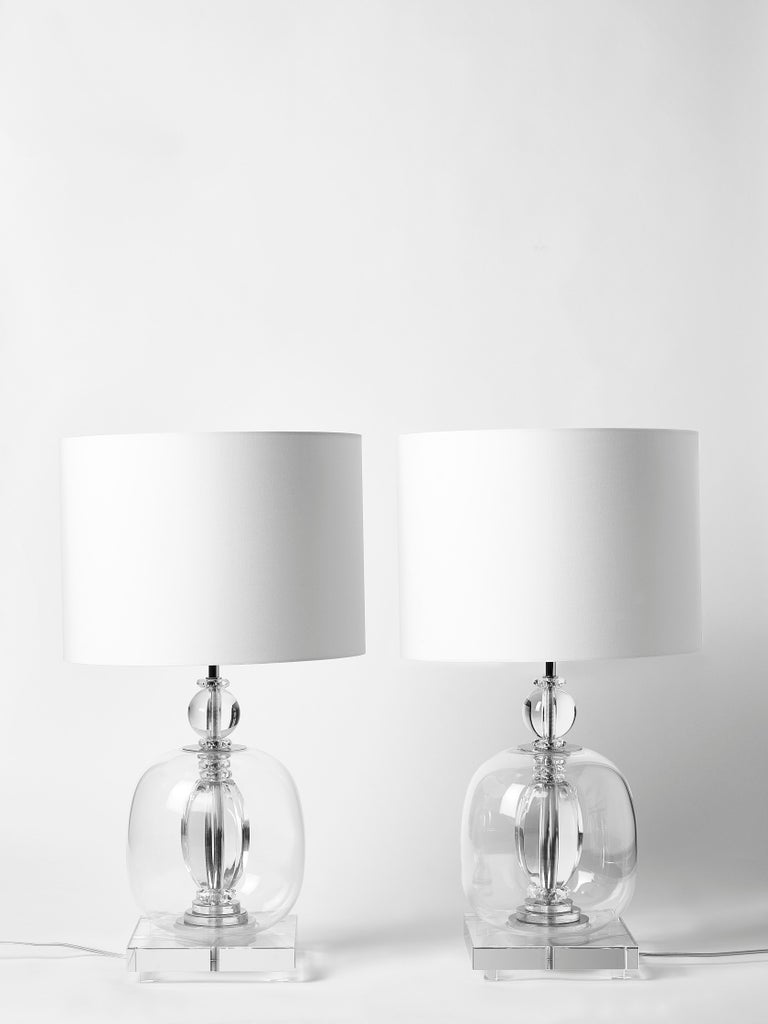 Pair of table lamps made of a stack of different pieces of transparent plexiglass and Murano glass giving the lamp a very clean and pure aesthetic.
