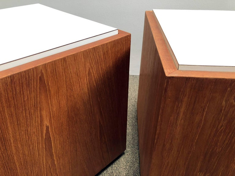 Pair of teak and Formica cube tables. Features removable tops for storage. Price is for the pair.