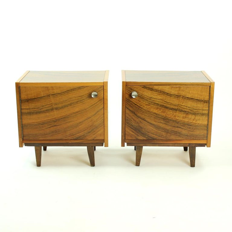Pair of bedside tables that look just amazing! Made in a cubical shape with walnut veneer. Produced in Czechoslovakia in 1970s by a National Furniture Company in Topolcany. The tables were kept in great condition as they are still untouched but