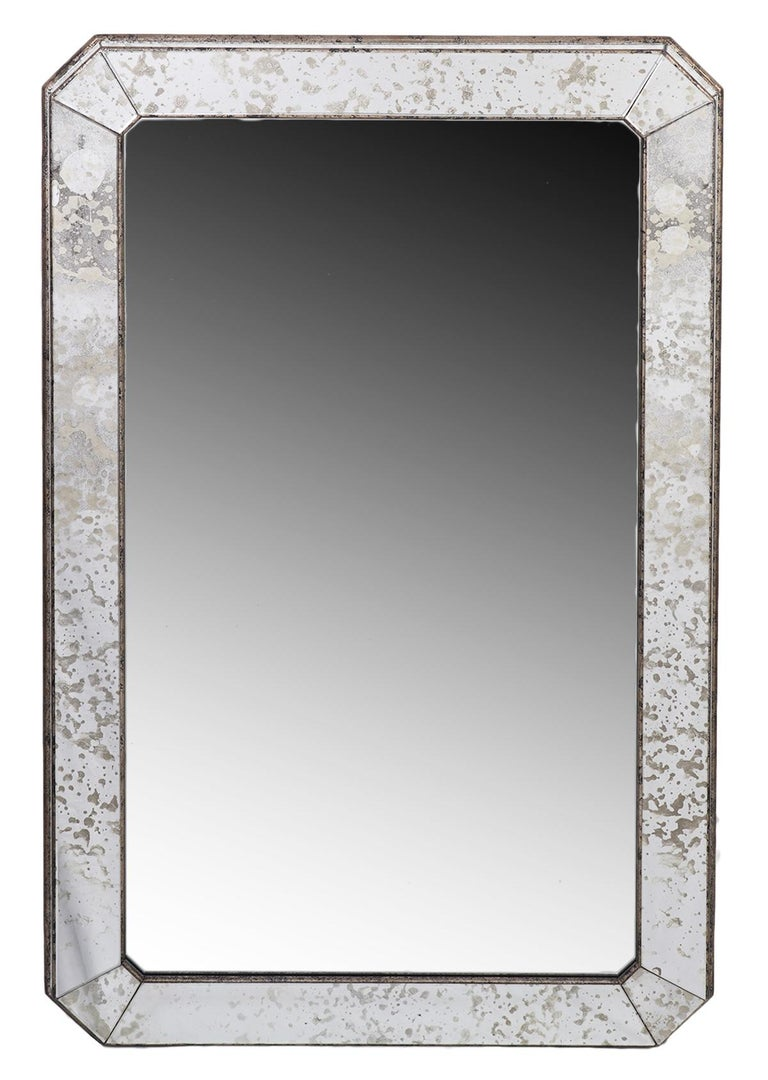 Echoing the masterful adeptness that Venetian glass makers achieved when they turned their attention to furniture, these mirror feature wooden silver toned frames with panels of mottled glass that contributes to the cohesive design.
