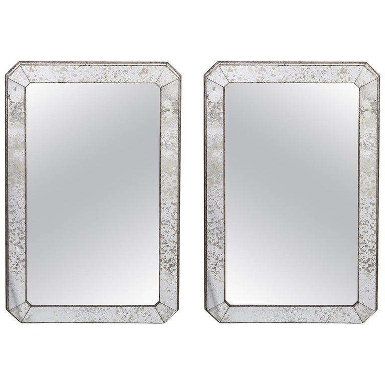 Pair of Currey & Co. Mirrors in Wooden Antiqued Glass Paneled Frames 20th C. For Sale