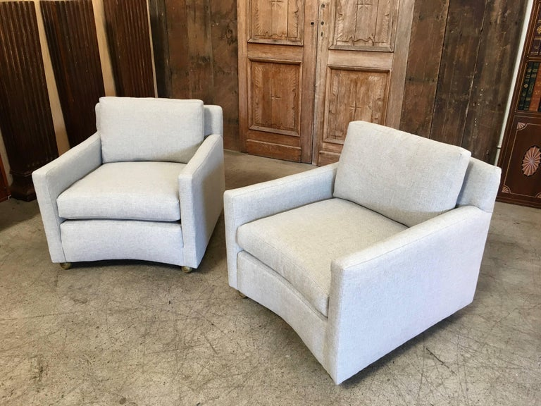 Very angular with curved front and back club chairs. Down filled cushions for the best comfort and the practicality of casters to keep these mobile with that floating look.