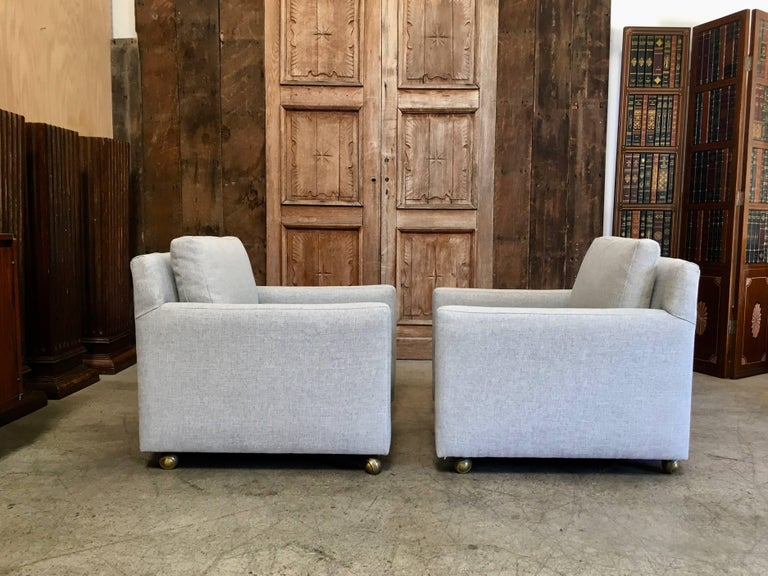 Mid-Century Modern Pair of Curved Back 1950s Lounge Chairs on Casters For Sale