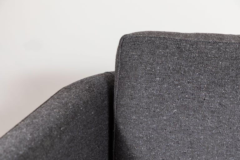 The curved back swivel chair is a tuxedo style lounge chair with curved corners and a metal base. The chair features down-wrapped, removable seat and back cushions.   Available to order in customer's own material with a 6-8 week lead time.   As