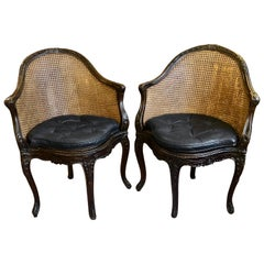 Pair of Curvy Carved Walnut and Double Caned French Louis XVI Style Chairs