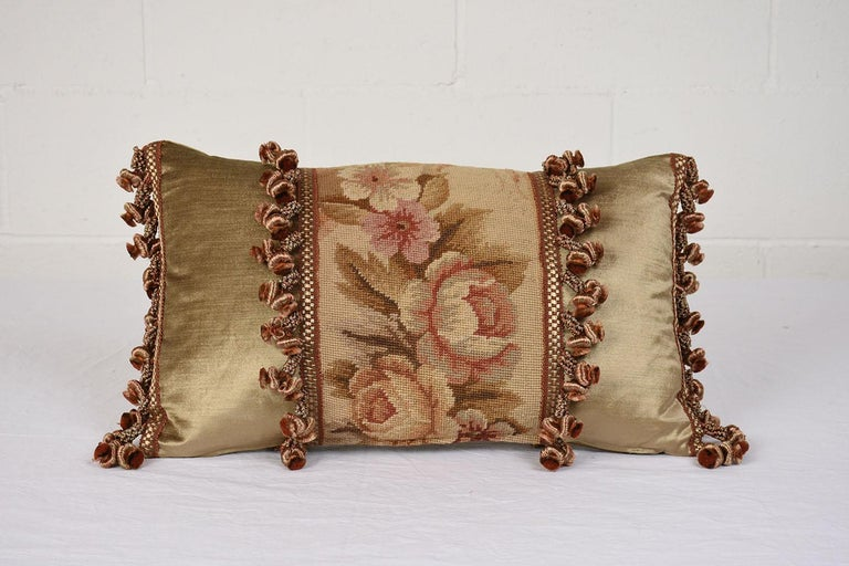 This beautiful pair of French accent decorative pillows are made out of antique floral pattern tapestry and combination with gold color velvet fabric on the sides and back and beautifully finished with decorative multicolored tassels and down